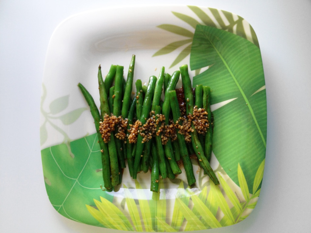 A quick stir-fry for green beans with caramelized garlic and oyster sauce.