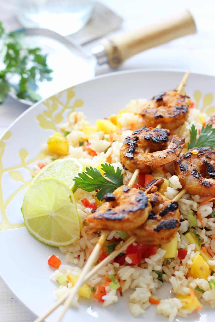 A fresh and delicious tropical mango salad with grilled curry shrimp. Use rice, quinoa, couscous, cauliflower rice or just about any grains!