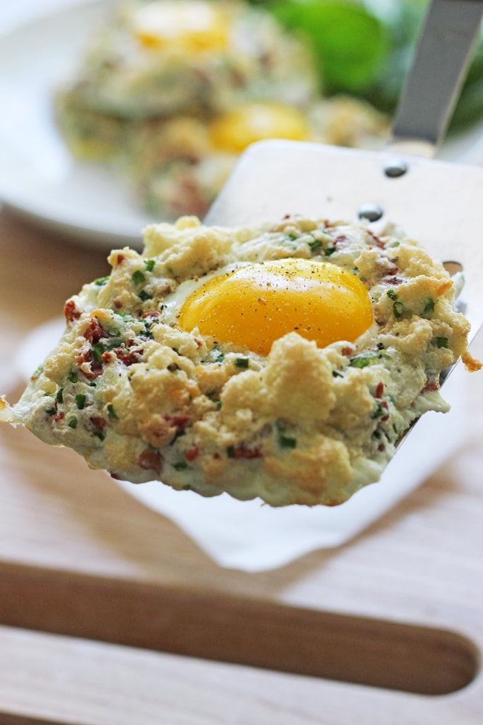 Eggs in clouds make a great, low calorie breakfast with fluffy egg whites baked with crumbled bacon, chives and Parmesan cheese and a nestled egg yolk.