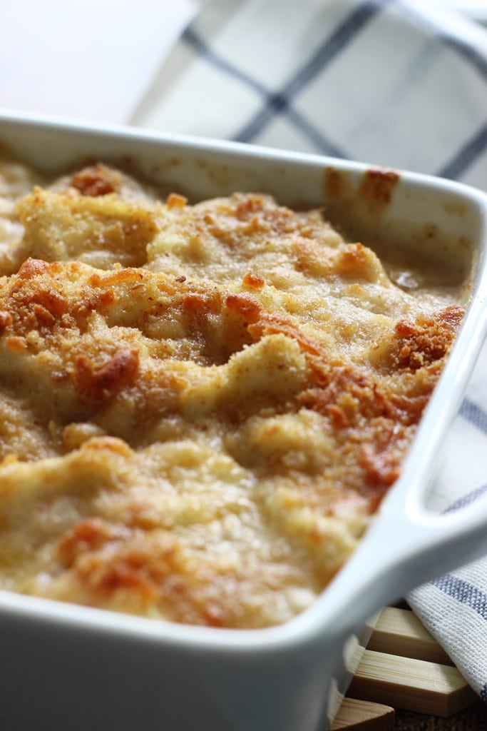 A cheesy, creamy cauliflower Au Gratin casserole with rich Bechamel sauce topped with a crusty layer of breadcrumbs and cheese.