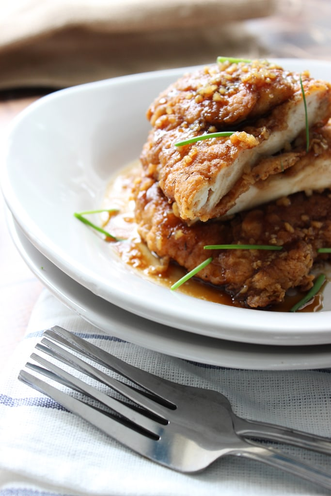 Crispy honey garlic chicken is a fast fix for dinner for two with a double battered spice mix served with honey garlic sauce.