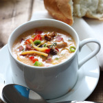 Creamy spicy chicken and corn chowder is the perfect soup for fall. With rotisserie chicken, corn, bacon, jalapenos, bell peppers and cheddar cheese.
