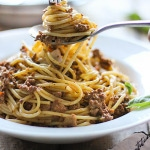 Indulge your pasta craving with this creamy, slow cooker meat pasta sauce. Cooking it low and slow brings out the best flavors!