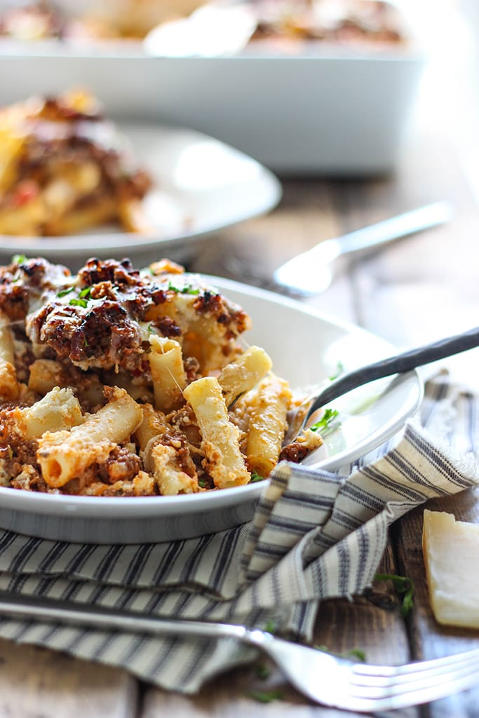 Baked Ziti is a great family meal to bring to the table with 3 kinds of cheese, a hearty meat sauce and a cheesy browned top!