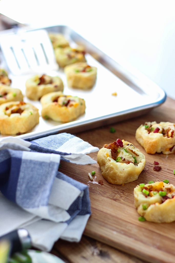 Make a great appetizer with these loaded potato pinwheels. Made form frozen crescent rolls, leftover mashed potatoes, bacon bits and cheese!