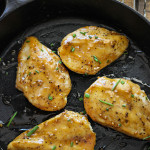 Maple glazed chicken breasts in a cast iron skillet.