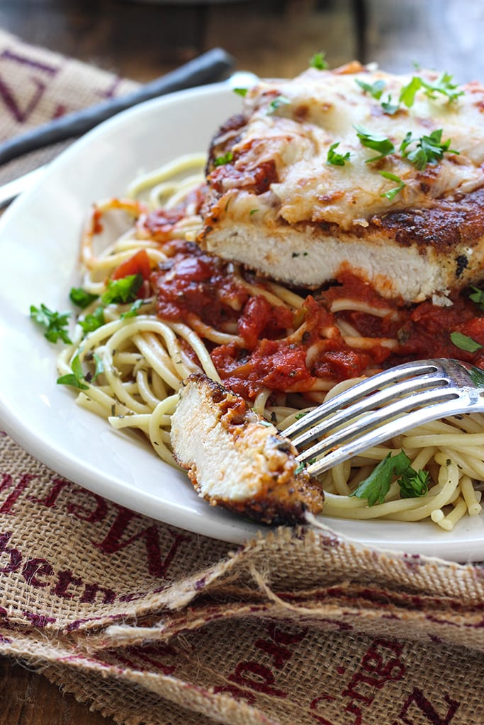 This skillet chicken Parmesan is ready under 30 minutes. With Parmesan herbed breading served with mozzarella cheese and marinara sauce.