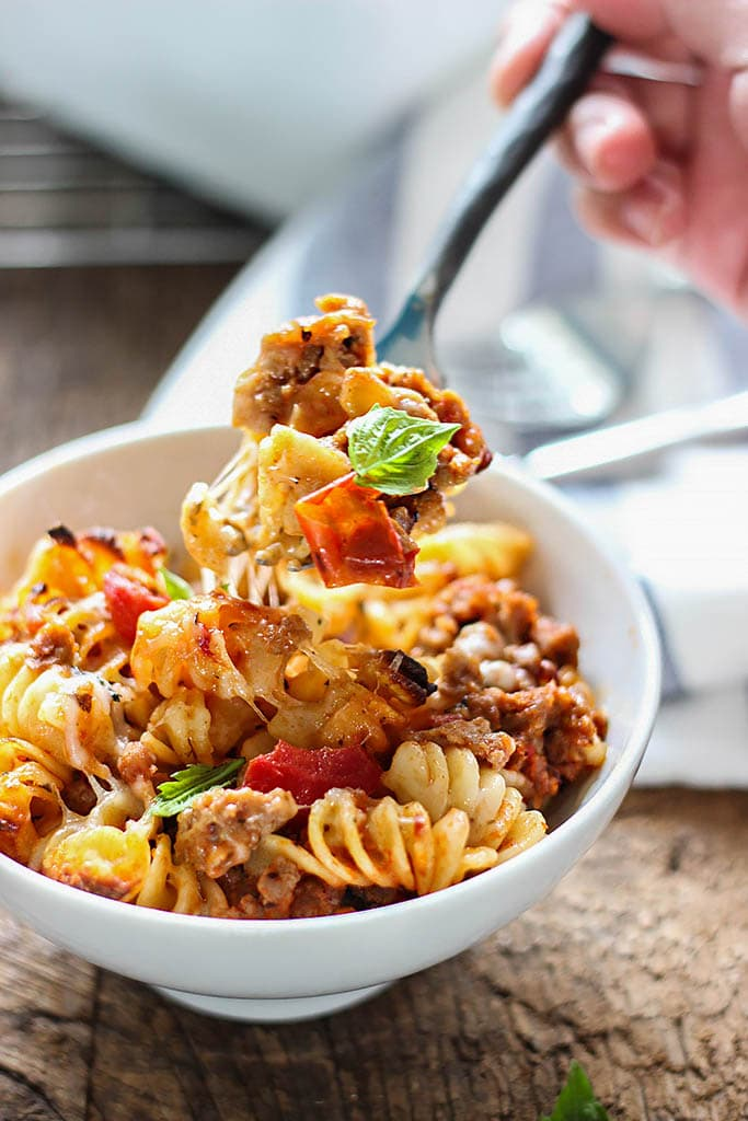 A cheesy hot Italian pasta bake with a spiced savory and sweet marinara sauce, hot Italian flavors and plenty of cheese.