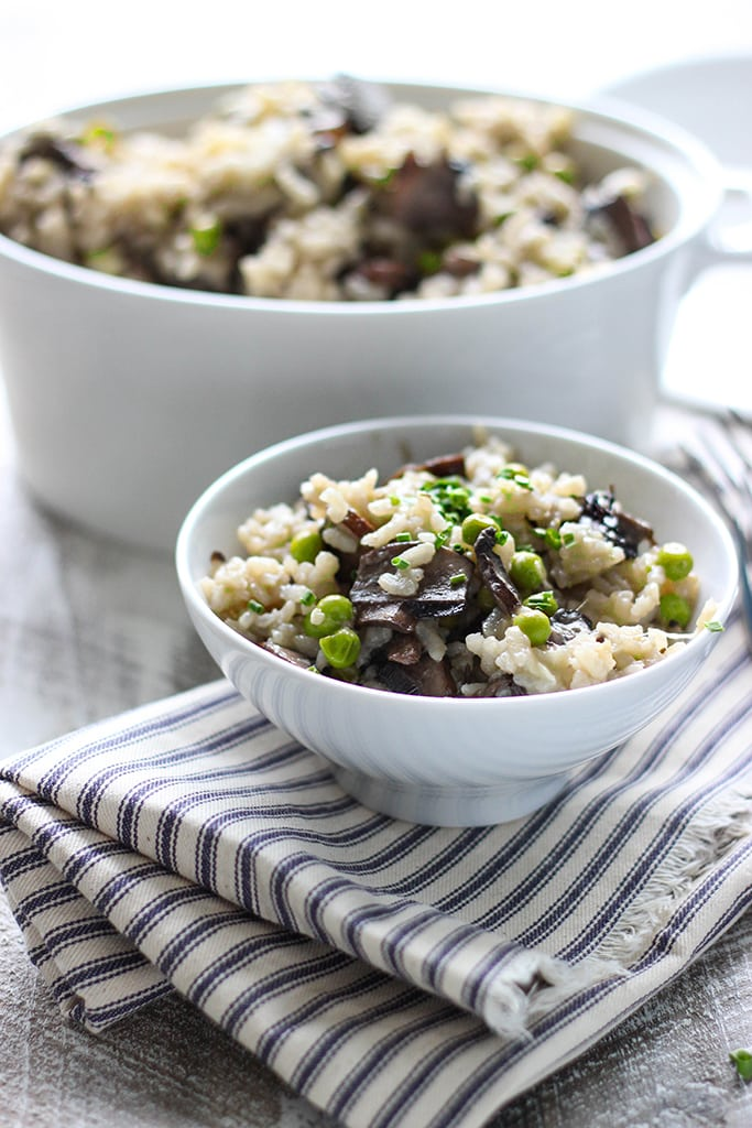Some slow cooker mushroom risotto in a white bowl.