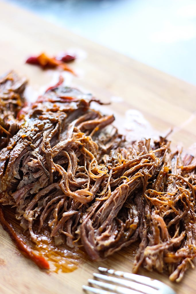 Fork-tender strands of pull apart flank steak simmering in a spicy tomato sauce makes this slow cooker Ropa Vieja something you should not miss.