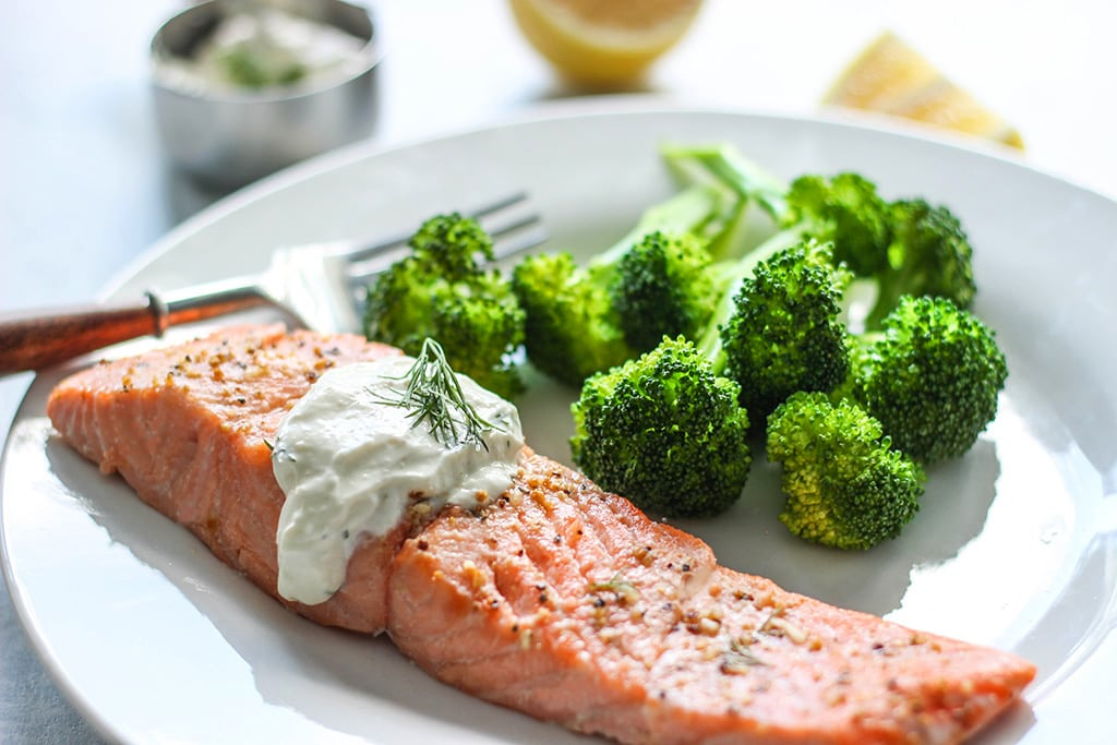 A quick and easy recipe for salmon in creamy dill sauce for two. Seasoned baked salmon paired with a sour cream sauce infused with lemon and fresh dill.