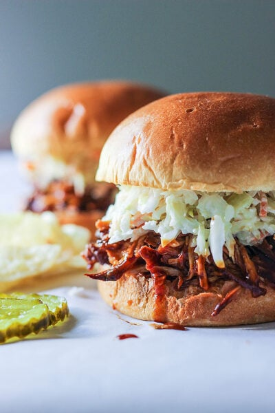 A no fuss recipe for slow cooker BBQ pulled chicken. It's literally set and forget until it's time to eat. Serve with coleslaw, pickles and chips!