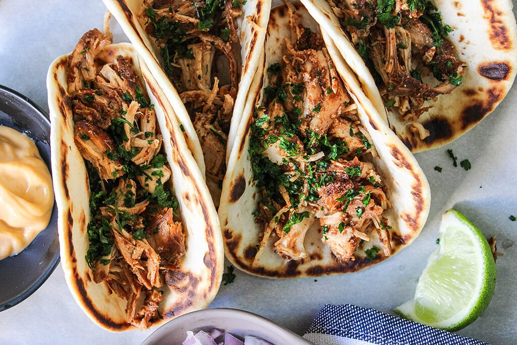 Set and forget these slow cooker shredded chicken tacos then enjoy fork-tender, authentic tasting, flavorful chicken. Pair it with your favorite toppings!
