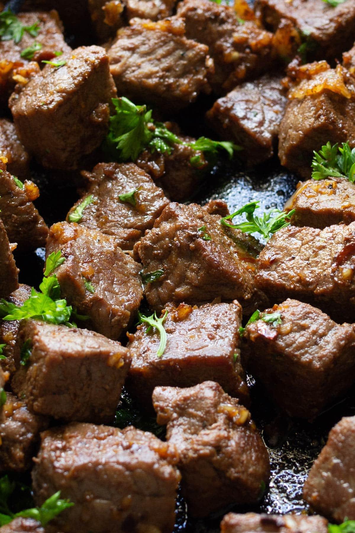 A close up of garlic butter steak bites.
