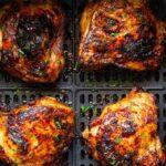 Air fryer maple chicken thighs in an air fryer insert.